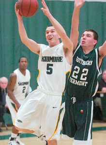 Skidmore's Gerard O'Shea goes up as Southern Vermont's Brandon Johnson pressures from behind during Tuesday's game at Skidmore. Ed Burke 11/22/11