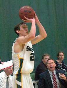 Skidmore's Brian Lowry hits for three during Tuesday's basketball matchup against St. Lawrence. Ed Burke 1/24/12