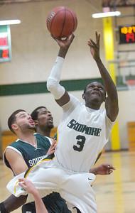 Skidmore's Nanribet Yiljep attacks the basket during Tuesday's game at Skidmore. Ed Burke 11/22/11