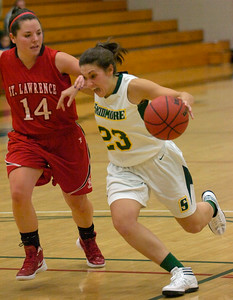 Skidmore's Christina Gargiso drives the ball around St. Lawrence's Cassie St. Hilaire during Tuesday's basketball matchup at Skidmore. Ed Burke 1/24/12