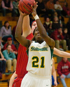 Skidmore's Angela Botiba tries for two under pressure from St. Lawrence's Kelly Legg during Tuesday's basketball matchup at Skidmore. Ed Burke 1/24/12