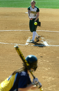 Skidmore's Katie Sorochka delivers a pitch to Cazenovia's  Jenna Kraeger during the first game of Saturday's softball doubleheader at Wagner Park. Ed Burke 3/30/13