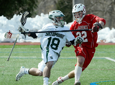 St. Lawrence defender Brian Wilber pressures Skidmore's Bryan Connolly during Saturday's Liberty League matchup at Skidmore. Ed Burke 2/23/13