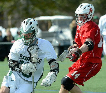 Skidmore's J.P. Sullivan protects the ball while being pursued by St. Lawrence defender Josh Robinson during Saturday's Liberty League matchup at Skidmore. Ed Burke 3/23/13