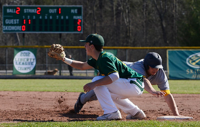 MCLA's Slayter Aubin slides safely back to first base with Skidmore's Mike LaVita on base during their home baseball game on Denton Road on Wednesday afternoon. Photo Erica Miller 4/17/13 spt_SkidMCLA3_Thurs
