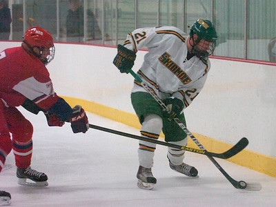 New England College's Andre Stalberg pressures Skidmore's Tony Giacin during Friday's game at Saratoga Springs Ice Rink. Ed Burke 11/9/12