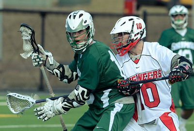 Skidmore's J.P. Sullivan gets tangled up by RPI defenseman Sam Resk during Wednesday's Liberty League matchup in Troy. Ed Burke 4/3/13