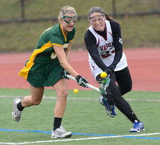 Skidmore's Emma Harris loses the ball under pressure from Vassar's Catherine Fiore during Friday's Liberty League matchup at Skidmore. Ed Burke 4/12/13