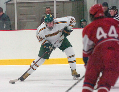Skidmore's Vlad Gavrik hits a slapshot on goal during Friday's game against New England College at Saratoga Springs Ice Rink. Ed Burke 11/9/12