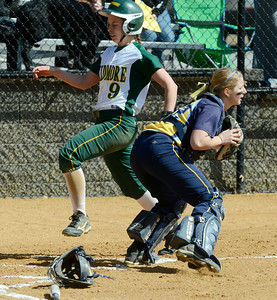Cazenovia catcher Hiliary Hext waits for the throw as Skidmore's Carol Brown scores on a base hit by teammate Lila Rosenfeld during the first game of Saturday's doubleheader at Wagner Park. Ed Burke 3/30/13