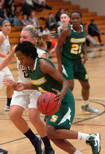 Skidmore's Jordan Wartts drives the ball to the basket past Ithaca's Kathryn Campbell. Ed Burke 11/17/12
