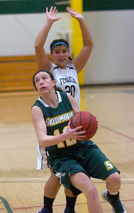 Skidmore's Allie Keller takes aim after getting around Ithaca defender Jenn Escobido. Ed Burke 11/17/12
