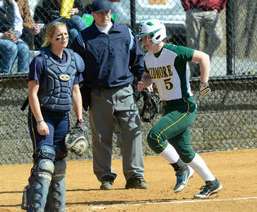 Skidmore's Mackenzie Whiting scores from second on a bunt from teammate Katie Amo during the first game of Saturday's doubleheader versus Cazenovia at Wagner Park. Ed Burke 3/30/13