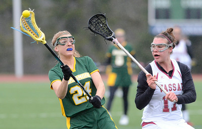 Skidmore's Robin Fetterolf gets off a pass as Vassar's Michela Garrison closes in during Friday's Liberty League matchup at Skidmore. Ed Burke 4/12/13