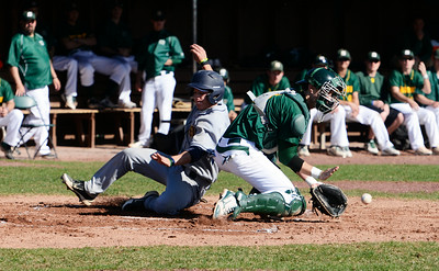 MCLA's J.T. Ferraro's slides safely to home plate as Skidmore's catcher Geoff Green catches the ball during their home baseball game on Denton Road on Wednesday afternoon. Photo Erica Miller 4/17/13 spt_SkidMCLA2_Thurs