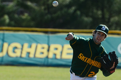 Skidmore's pitcher Dan Brown warmed up between innings during their home baseball game on Denton Road against MCLA on Wednesday afternoon. Photo Erica Miller 4/17/13 spt_SkidMCLA4_Thurs