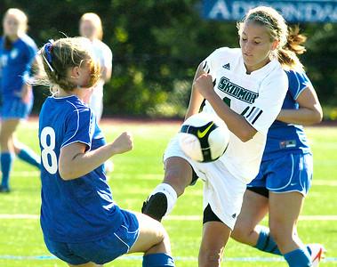 Skidmore's Maggie Abernathy advances the ball past Wellesley College's Liz Regan. Ed Burke 9/19/09
