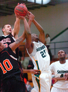Skidmore's Melvis Langyintuo is fouled by Cobleskill's Andrei Lucas during Tuesday's season opener for the Thoroughbreds at Skidmore College. Ed Burke 11/17/09