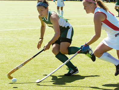 Skidmore's Sheray Michel drives the ball down the field against Cortland's Angela Hughes during their field hockey game Sunday afternoon. Photo Erica Miller 9/6/09 spt_SkidCort1_Mon