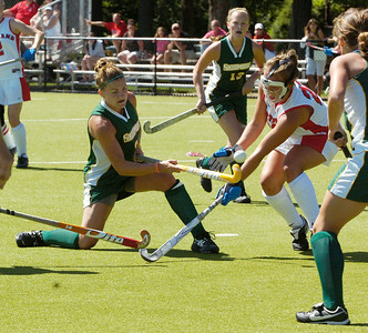 Skidmore's Christine Kemp takes a shot at the goal as Cortland's Christine McCabe tries to block the ball during their field hockey game Sunday afternoon. Photo Erica Miller 9/6/09 spt_Kemp3_up