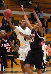 Skidmore's Sakhile Sithole drives between Cobleskill's Damion Longmore (32) and Andrei Lucas during Tuesday's season opener for the Thoroughbreds at Skidmore College. Ed Burke 11/17/09