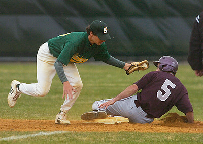 Vassar's Ari Glanfz beats the tag by Skidmore's Jake Mendell and is safe at second base during the first game of a doubleheader Saturday at Castle Diamond. Ed Burke 4/18/09
