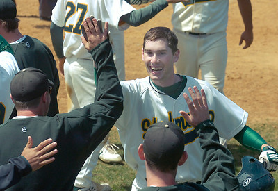 Skidmore's Zack Rudman receives multiple high-fives after his third inning homerun during the the first of Saturday's doubleheader against RPI at Castle Diamond. Ed Burke 5/2/09