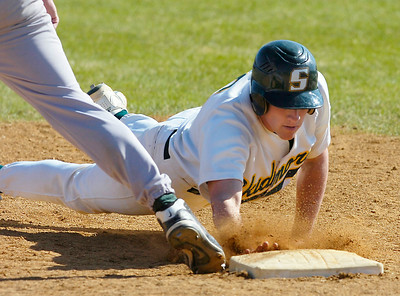 Skidmore's Dave Bershad dives back to first beating the tag during Thursday's game against Southern Vermont College. Ed Burke 4/16/09