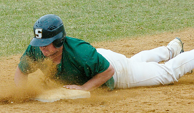 Skidmore's Matt Pisani is safe on a slide into third base in the second inning of the first game in Saturday's doubleheader against Vassar at Castle Diamond. Ed Burke 4/18/09