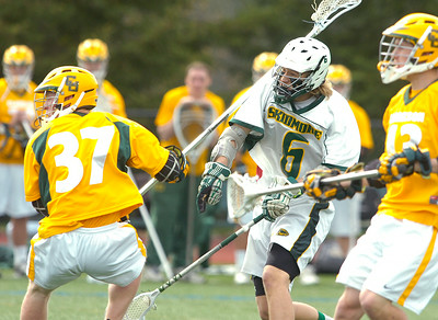 Skidmore's Ben Cornell scores Clarkson's Evan Renwick, left, and Kyle Alexander watch the Cornell's shot hit the net during Friday's game at Skidmore College. Ed Burke 5/1/09