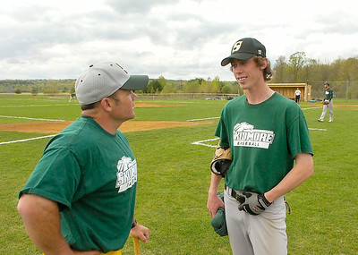 Brian Lowry talks with Skidmore baseball coach Ron Plourde during Wednesday's practice at Castle Diamond. Ed Burke 5/6/09