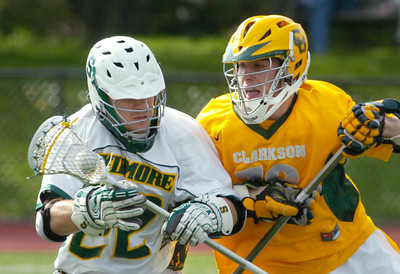 Skidmore's Tom Levesque advances under pressure from Clarkson's Mike Simmons during Liberty League lacrosse action Friday at Skidmore. Ed Burke 5/1/09