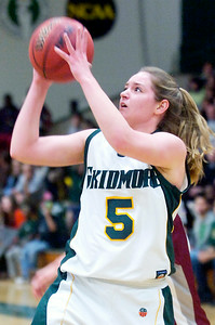 Megan Gaugler, Skidmore, takes a shot at the basket during their basketball game against Vassar College Saturday afternoon. Photo Erica Miller 2/13/10 spt_SkidVas1_Sun