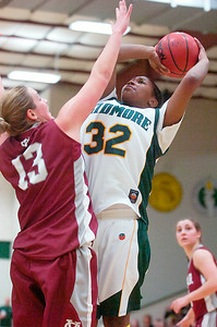 Antonia Williams, Skidmore, takes a shot at the basket against Kristyn Tempora, Vassar, during their basketball game Saturday afternoon. Photo Erica Miller 2/13/10 spt_SkidVas3_Sun