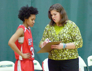 RPI women's basketball assistant coach Sarah Lombard talks with player Whitney Coleman during Saturday's game at Skidmore. Ed Burke 2/28/10