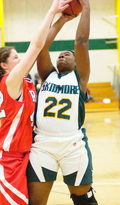 Skidmore's Ismatu Alison-Konteh looks for a shot past RPI defender Hilary McKinley during Saturday's game at Skidmore. Ed Burke 2/28/10