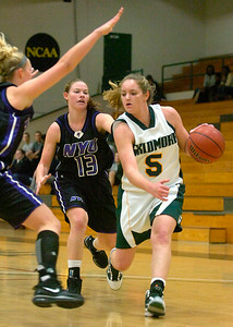 Skidmore's Megan Gaugler drives to the basket around NYU's Emily Foshag. Ed Burke 12/3/09