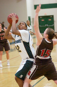 Skdimore's Antonia williams looks for a shot while guarded by St. Lawrence defender Abby Stanton during Saturday's Liberty League matchup at Skidmore College. Ed Burke 1/23/10