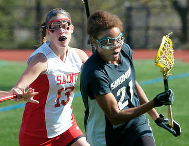 Skidmore's Amber Kinsey stays ahead of St. Lawrence defender Nora Langan during Friday's game at Skidmore College. Ed Burke 4/23/10