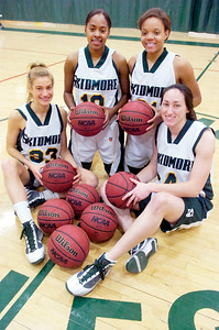 Seniors for the Skidmore Girls Basketball (L-R) Dana Leonard, Sharlyn Harper, Amber Kinsey, and Kelly Bischoff. Photo Erica Miller 2/17/10 spt_SkidFour1_up