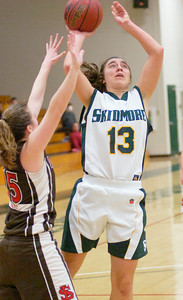 Skidmore's Logan Frederick shoots over defense by Abby Stanton of St. Lawrence during Saturday's Liberty League matchup at Skidmore College. Ed Burke 1/23/10