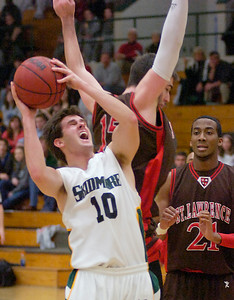 Skidmore's Jeff Altimar grimaces during close play underneath the basket against St. Lawrence defender Jack Conboy during Saturday's Liberty League matchup at Skidmore College. Ed Burke 1/23/10