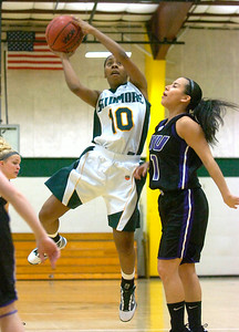 Skidmore's Sharlyn Harper goes up for a shot as NYU's Jen Hum-Traverso closes in. Ed Burke 12/3/09