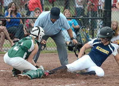 Greenwich catcher Mariah  Linnett gets the out at home on Albany Academy's Carylann Geddes during Sectional action Wednesday at Moreau Recreational Park. Ed Burke 5/29/13