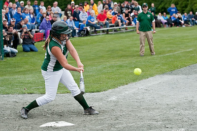 Greenwich's Samantha Whitehouse makes a solid connection with the ball Saturday morning during the Section III State Semifinal softball game against Sandy Creek. Photo Eric Jenks 6/8/13