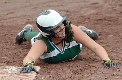 Greenwich runner Kali Nolan gets back to first safe during Sectional action Wednesday at Moreau Recreational Park. Ed Burke 5/29/13