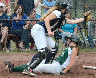 Greenwich runner Ashleigh Maines beats the throw to Albany Academy catcher Emily Padalino and is safe at home to end an extra-innings sectional playoff Wednesday at Moreau Recreation Park. Ed Burke 5/29/13