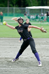 Troy Pitcher Hunter Levesque throws the ball Saturday morning during the Section III Class A State Semifinal softball game against Sayville. Photo Eric Jenks 6/8/13