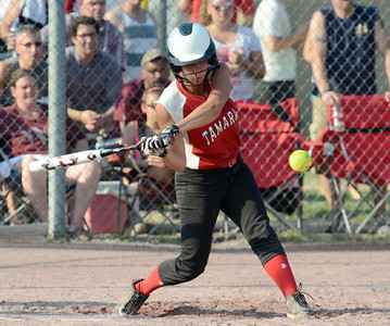Tamarac's Briana Matazinsky swings into a pitch duringFriday's Section II Class D final versus Chatham at Clifton Common. Ed Burke 5/31/13