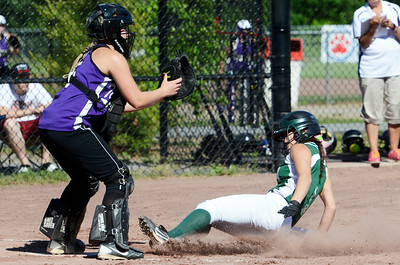 Greenwich's Alexis Case slides safely into home plate against Ticonderoga's catcher Katie Palandrani during their softball regional game. Photo Erica Miller 6/3/13 spt_Softball2_Tues